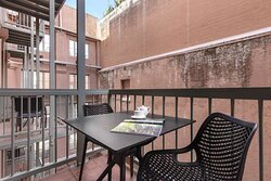 Dining area on balcony of One Bedroom Suite