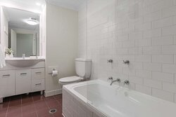 Interior view of bathroom in One Bedroom Suite with bathtub