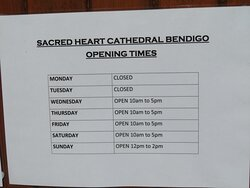 Opening times notice fixed to the outside of the side door at the western end of the cathedral.
