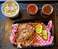 Pulled Pork Sandwich on Texas Toast to go with slaw , pickles , sweet bbq , and Carolina Bbq - Uncovered