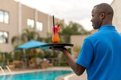 Pool Bar Staff Carrying Drink