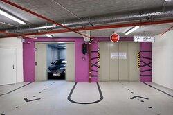Hotel Parking Garage Car in Elevator
