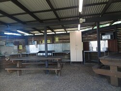 Camp kitchen with sink to far left, BBQ centre, microwave, toaster, jug far right. Located at the top of the complex