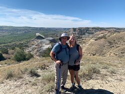 My wife and I with overlook behind us