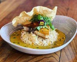 Spiced Swordfish served with a curry sauce, mango chutney, rice and a popadom