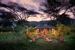 Sundowner set-up around the fire at Angama Safari Camp