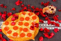 Díselo con una pizza. El amor entra por los ojos y el estómago.