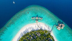 Aerial shot of the island and Over Water Villas