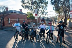 A group of adults and teenagers on e-bikes, the Scenic Cycle Tour