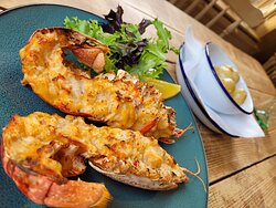 Lobster Thermidor with garlic buttered new potato.