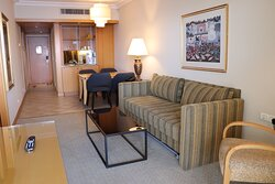 Royal Suite living room, kitchenette and dining area at Aria Hotel Eilat