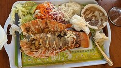 By far the best lobster I ever had. Well worth the stop for lunch, beer/margarita. The staff was friendly. The cook brought out the fresh lobster and fish he was cooking for us. One of the oldest restaurants in this area. Was highly recommended place for seafood by the locals.