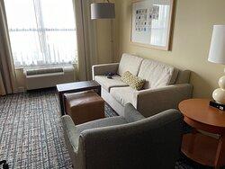 Living room area. Kinda small width-wise, it's plenty of space.