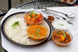 Paneer and mix veg curry. Indian vegetarian Thali combo served with bread and Mango Lassi