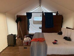 Under Canvas bed and bath area