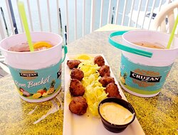 Drink Buckets and Conch Fritters