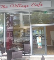 ‪The Village Cafe‬