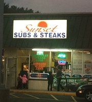 ‪Sunset subs & steaks‬