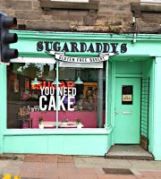 ‪Sugar Daddy's Bakery‬