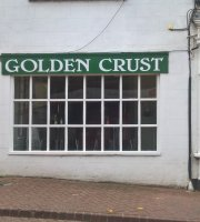 ‪Golden Crust‬
