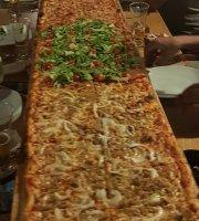 Encanto Metros de pizza