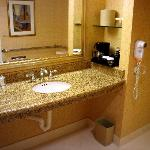 Room 1066 bathroom with granit vanity and coffee maker