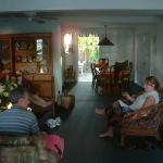 Lounging downstairs, looking towards the dining room and back porch.