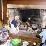 MaryBeth cooking at the hearth