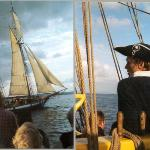 Lady Washington's captain eyes the Lynx at the end of the Pirate Battle Sailing out of...