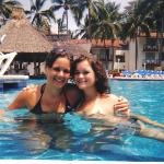 me and my friend in the pool! The swim up bar behind us... best part!