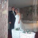 The bride and groom in the Royal Suite (taken via the mirrored closet)