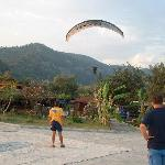 Cool paragliders coming in to land