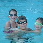 The kids swimming in the Ramada in outside pool