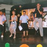 The winners of the day's activities receive a bottle of champagne and do a dance with Jordi...