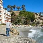 Hotel front and small beach. Balcon promenade in the back of picture.