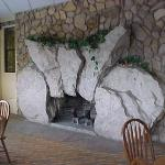 Beautiful stone fireplace in dining room (by famous local architect, Earl Young)