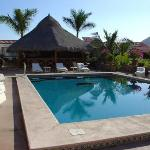 large palapa at poolside