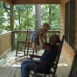 My son and my father on the deck of the cabin