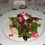 Restaurant's salad. Edible flowers from the garden.