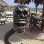 Funny carved guy watches the bar..