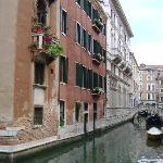 The Locando Orseolo is the red bldg.  Our room is on the top floor where the flowers are.