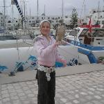 me holding a falcon at Port El Kantatoui