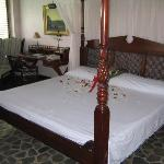 The flower strewn bed with complimentary bouquet of roses. The pillows and sheets are really...