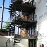 Spiral staircase leading to/from balcony area of some suites.