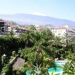 Side view from our balcony looking over the pool and gardens, with Mount Teide in the...