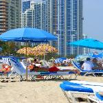 The Ocean Point beach is next to a public beach, but the only hint of this is the umbrellas.