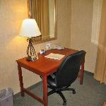 Room 333 work desk, office-style chair, and complimentary HS internet connection