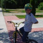 my son bike riding in the streets of Eagle