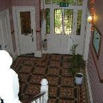 The impressive entrance hall (original Victorian tiled floor and stained glass in door)