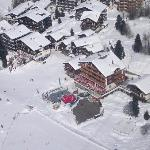 Hotel Waldesruh high up from the Alpin Express lift showing sun terrace and outside bar area